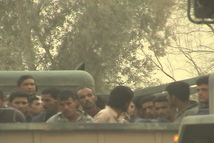 BAGHDAD, IRAQ - CIRCA 5/21/03: Iraqi detainees being transported in trucks at Abu Ghraib.