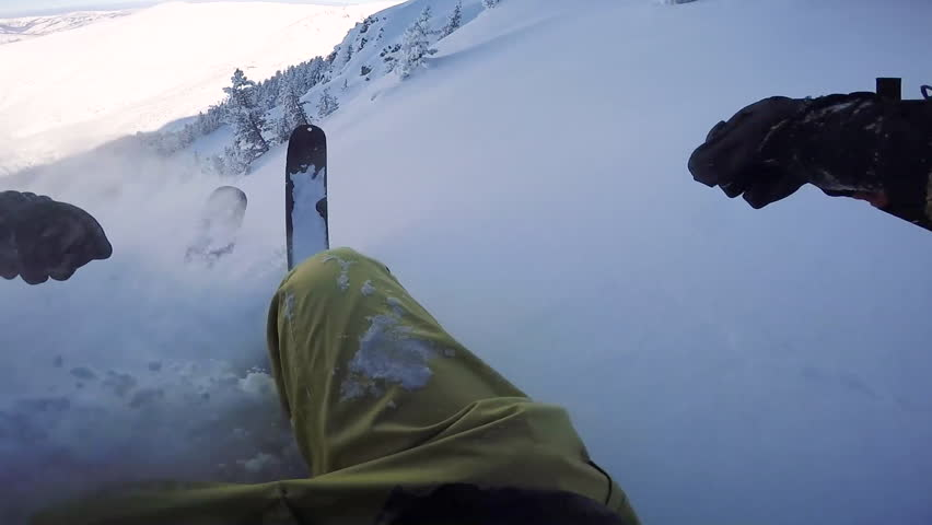 FIRST PERSON VIEW CLOSE UP: Unrecognizable skier riding fresh powder snow past the snowy trees in mountain forest. Freeride skier skiing in perfect powder snow in backcountry mountain ski resort | Shutterstock HD Video #19548271
