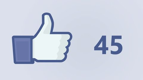 """ABERDEEN, SCOTLAND, SEPTEMBER 14, 2016: Facebook concept """"Like button"""" with 100 LIKE numbers on social network. Facebook is the most popular online social networking service in the world."""