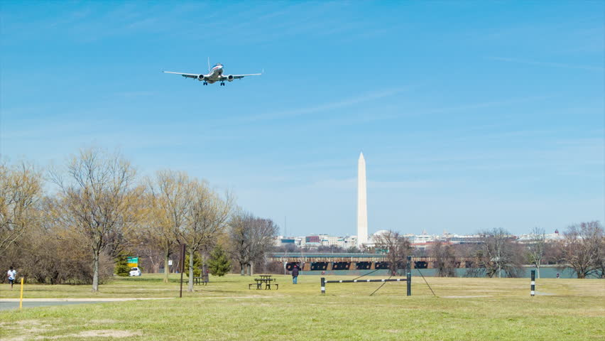 WASHINGTON DC - 2016: American Airlines Boeing 737 Passenger Jet Airliner Flying Over Gravelly Point Park on Final Approach at Ronald Reagan National Airport DCA