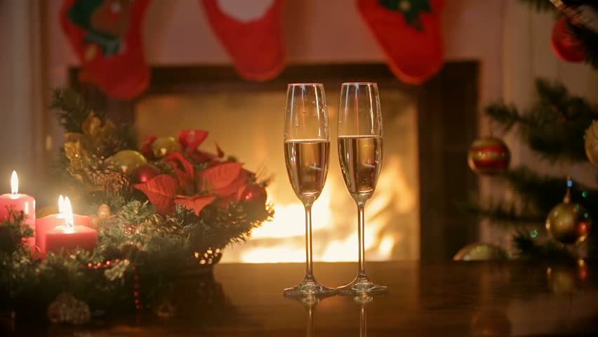 Dinner Table Background pouring champagne in two glasses on christmas dinner table