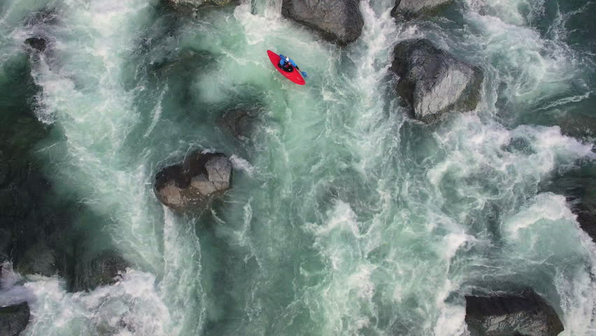 Overhead Aerial Shot of Man in Kayak on Raging River with Rapids #19688335