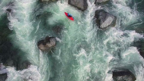 Overhead Aerial Shot of Man in Kayak on Raging River with Rapids