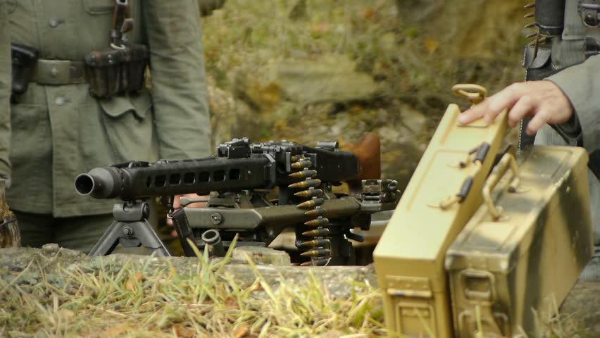 Second world war german soldiers armed with machine gun firearm