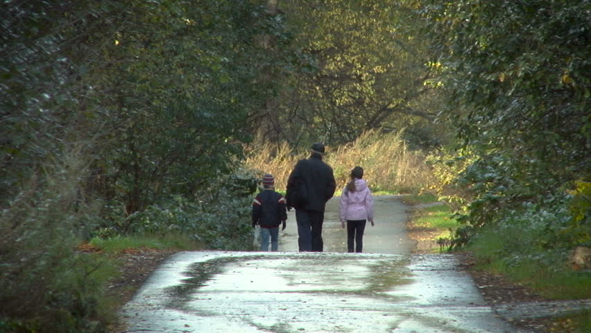 Old Man With 2 Grand Children Walking Down the Road in the Forest. Back View From the Distance. Early Autumn. First Snow on the Road. Wide Shot. | Shutterstock HD Video #19698256