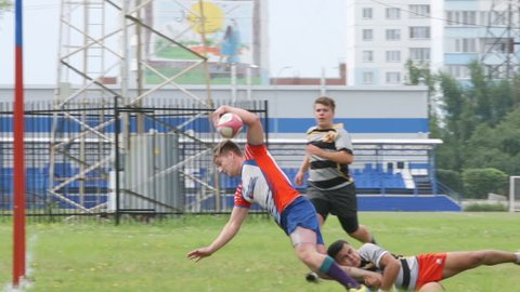 NOVOSIBIRSK, RUSSIA - JULY 30, 2016: Rugby defenders block a player but he scores