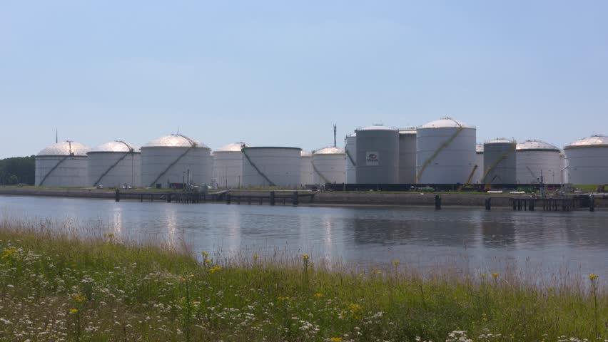 EUROPOORT, SEAPORT ROTTERDAM - JULY 2016:  Crude oil storage tanks alongside calandkanaal. Transshipment, supply of the refineries by pipeline