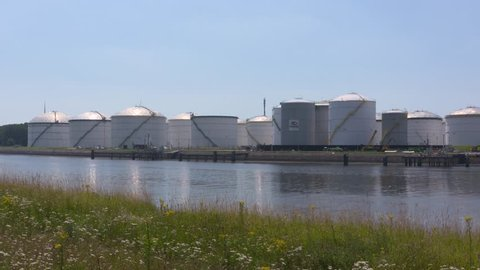 EUROPOORT, SEAPORT ROTTERDAM - JULY 2016:  Crude oil storage tanks alongside calandkanaal. Transshipment, supply of the refineries by pipeline