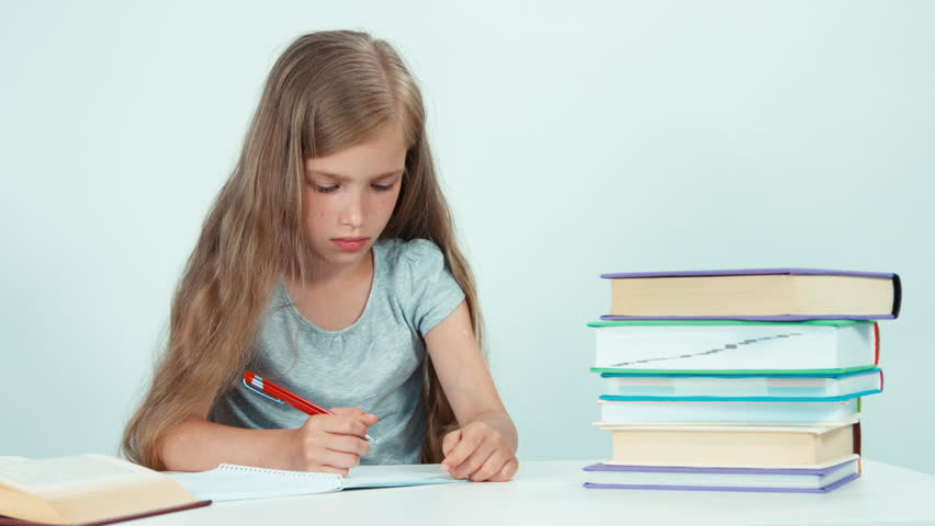 Girl something writing in her notebook and shrugs and looking at camera. Isolated on white. Panning   Shutterstock HD Video #19801855