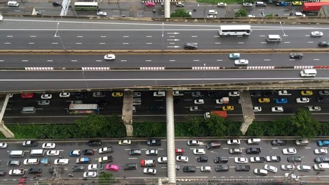 Aerial shot show traffic jam on super highway and tollway or express way in Bang Na, East Bangkok area, transportation concept, High quality footage 4K