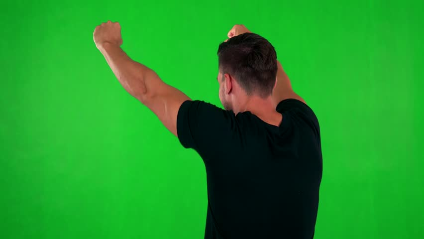 Young handsome caucasian man rejoices - shot on back (man looks to screen) - green screen - studio | Shutterstock HD Video #19819975