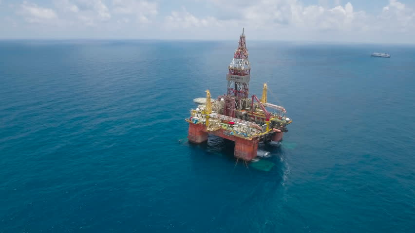 SOUTH CHINA SEA - JULY 2016: Flying towards a Chinese offshore oil drilling platform in the South China Sea, a strategic political and economic region with several conflicting territorial claims.
