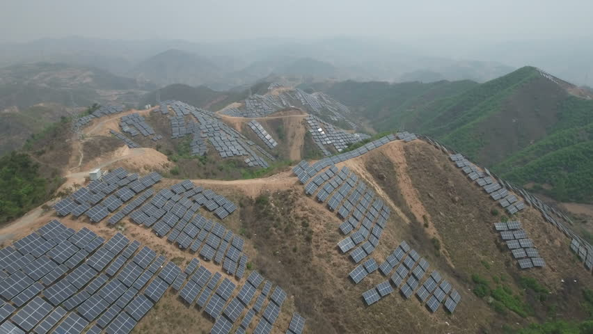 Aerial flight over a massive solar panel power project in the mountains near Qinhuangdao in Northern China #19838755