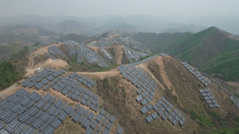 Aerial flight over a massive solar panel power project in the mountains near Qinhuangdao in Northern China