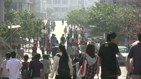 QINGDAO - 5 MAY 2010: Chinese students make their way to class at Qingdao University in Qingdao