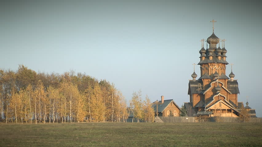 Wooden monastery in autumn forest. Svyatogorsk, Ukraine