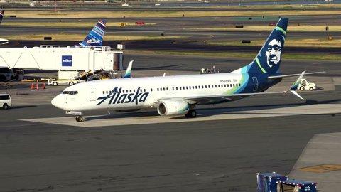 Alaska Airlines Boeing 737 arrives at terminal gateway - Logan Airport, Boston USA - August 30, 2016