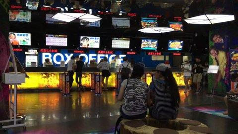 August.30,2016-Beijing,China:Customers buy film ticket in a Wanda IMAX cinema.  Wanda Cinema Line, Chinaâ??s biggest movie-theater operator