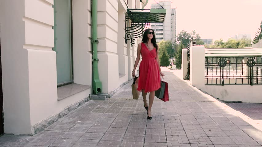 Wonderful brunette spins around with her shopping bags | Shutterstock HD Video #19885705