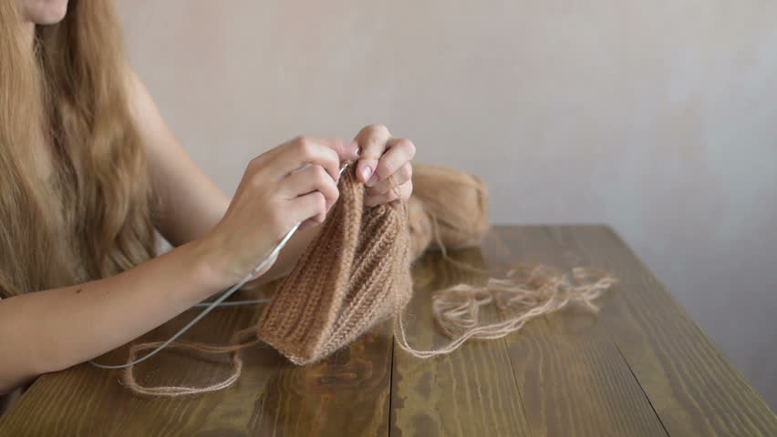 Knitting blonde woman