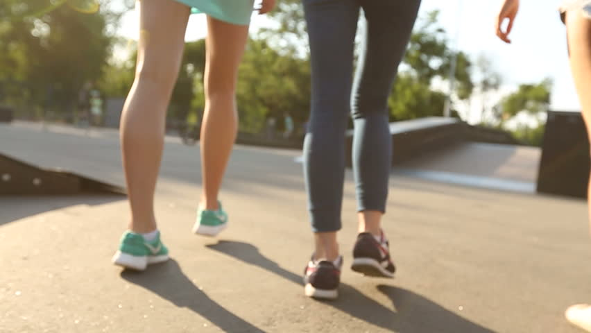 Camera follows feet of girls walk in skatepark on 24.07.2014 in Mariupol #19925785