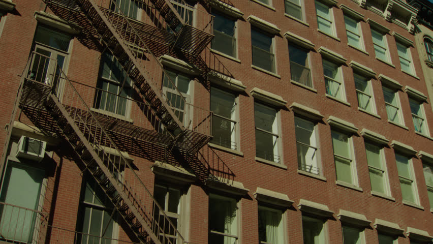 Day Hold tight side red brick apartment building office building fire  escapes  then Pan rightDay Tilt Up Raked Left Multi Story Grey Brick Apartment Condo  . Brick Apartment Building Entrance. Home Design Ideas