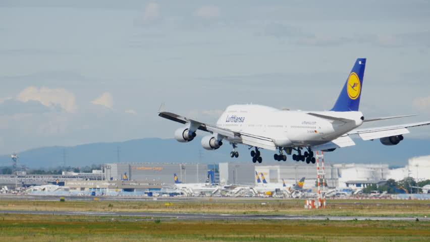 FRANKFURT AM MAIN, GERMANY - SEPTEMBER 4, 2015: Lufthansa Boeing 747 D-ABYK landing at 25L. Unofficial spotting on Sep. 4, 2015