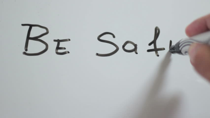 "Hand writing title ""be safe"" using a black marker on a white board 