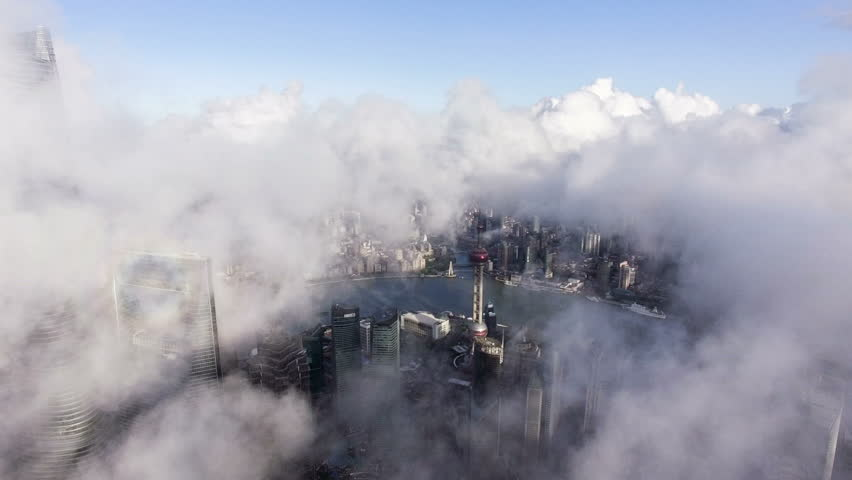 Bird view of the busy Pudong CBD in the sky at sunset,Shanghai, China  | Shutterstock HD Video #19982419