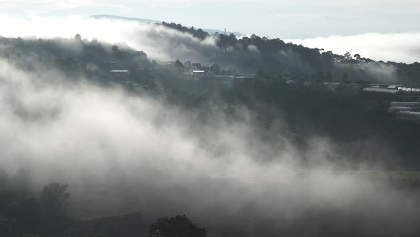Da Lat, Vietnam, sun rise on mountain in fog