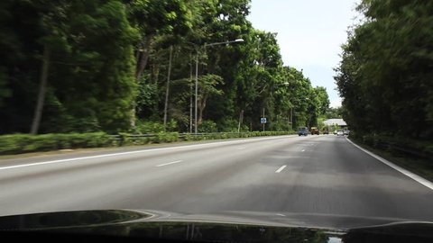 SINGAPORE - 21st SEPTEMBER 2016: View from vehicle of Eco-Link at BKE, wildlife bridge, opened in 2013, to span the BKE Expressway and link the Central Catchment and Bukit Timah nature reserves.