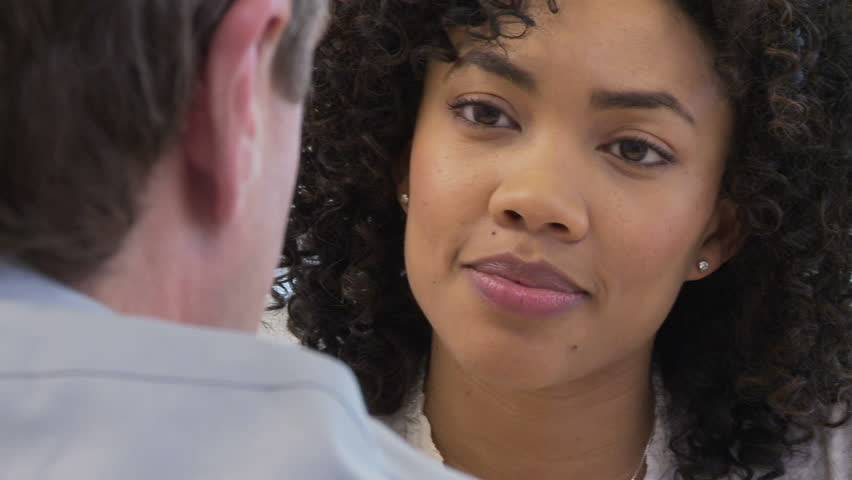 Close up faces of two business people talking | Shutterstock HD Video #2001875
