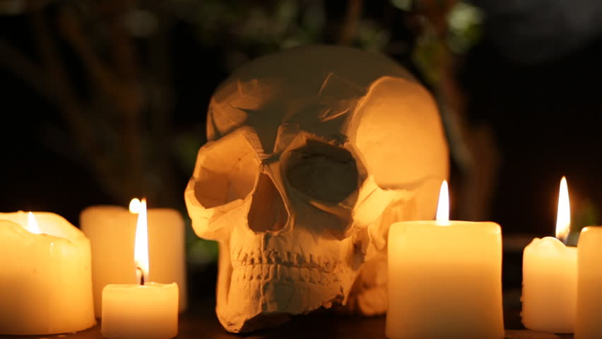 Abstract Halloween Background Composition with Skull and Candles. Seamless loop. Short Version | Shutterstock HD Video #20021515