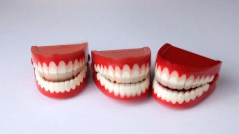 3 pair of clacking toy teeth