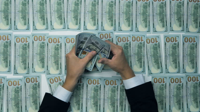 Cash, money, lot of hundred new dollar banknotes. Man counting money, new US dollars. Financial income, wages, sell, loan.   Shutterstock HD Video #20044285