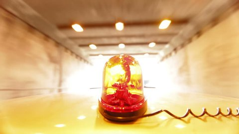 Car With Red Emergency Light Driving Through A Tunnel