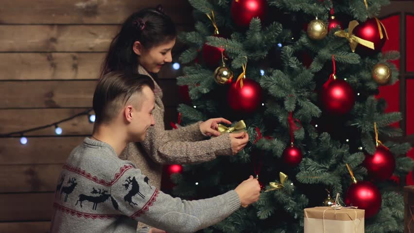 Mother With Her Daughter Dressing Up Christmas Tree Stock Footage ...