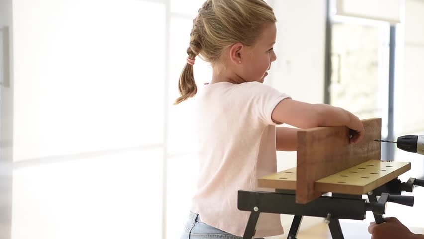 Footage in high definition of father explaining architectural little girl helping daddy with do it yourself work hd stock video clip solutioingenieria Choice Image
