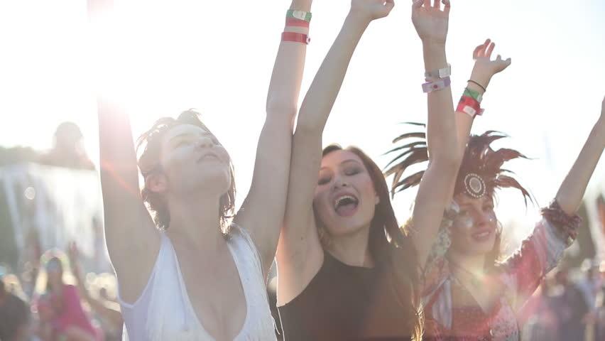 Female friends dancing at summer festival   Shutterstock HD Video #20116630