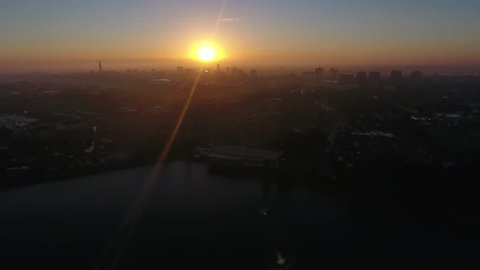 Aerial view of Birmingham city centre at sunrise from over Edgbaston reservoir.