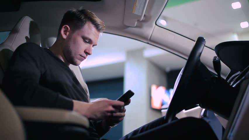 Man looking at the smartphone inside the car | Shutterstock HD Video #20155285
