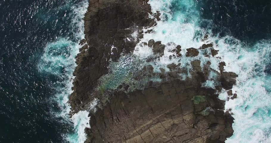 Aerial view of the rough coastline with waves on a Caribbean island, Sainte Anne, Martinique