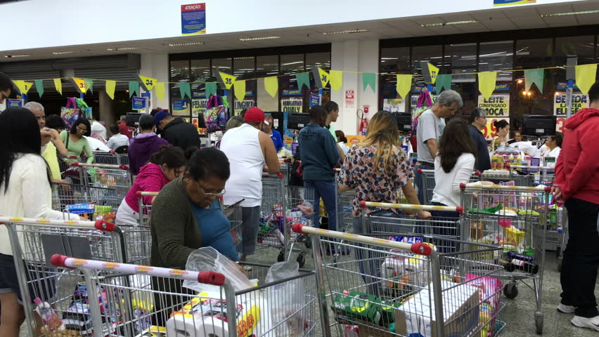RIO DE JANEIRO, BRAZIL - AUGUST 13: Extremely busy super market with long lines in Rio de Janeiro, Brazil on August 13, 2016 during Olympic Games season.