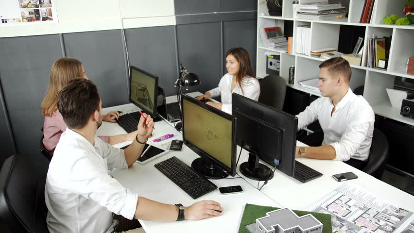 wide angle view busy design office. wide angle view of busy design office with workers at desks 20s 4k n
