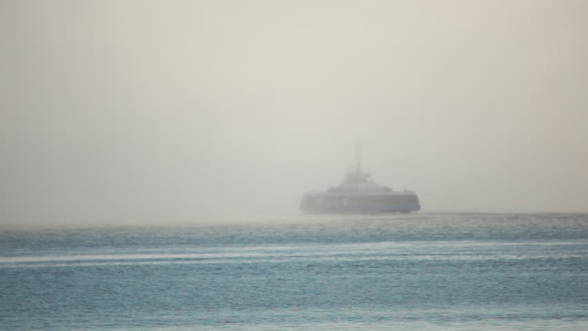 Ferry disappearing into fog #2017615