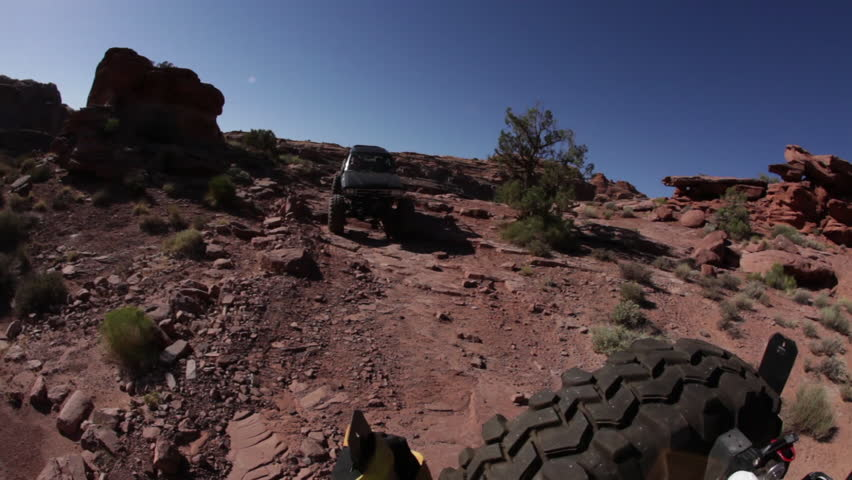 Truck Following a Jeep on a Rocky Trail