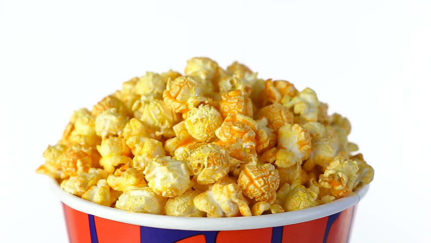 Cheese popcorn rotates on a white background. Close up shot | Shutterstock HD Video #20226835