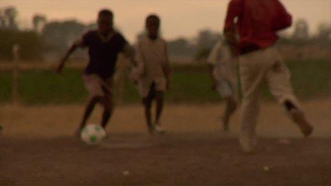 KENYA - CIRCA 2006: Unidentified little Kenyan children play soccer circa 2006 in Kenya.