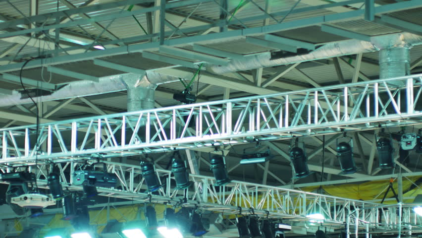 Spotlight System on the Ceiling of Exhibition Hall.metal structures below the ceiling of the stadium. they placed lighting equipment - projectors, lights, winches and laid electric wires. - 4K stock video clip