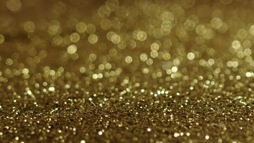 Golden glitter exploding , Red Epic slow motion clip | Shutterstock HD Video #20265565